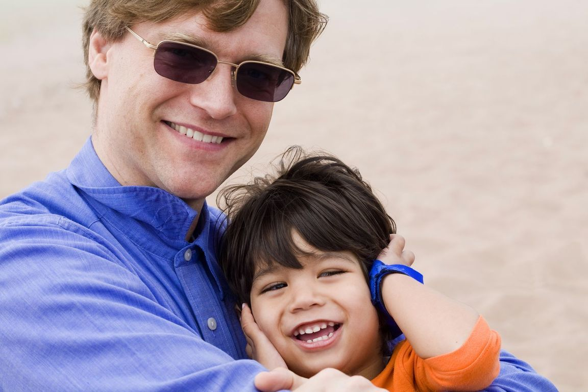 bigstock-Father-And-Son-Laughing-Togeth-60831413