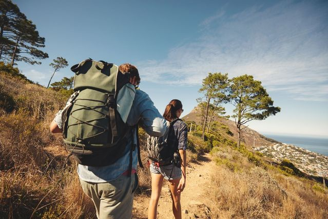 bigstock-Young-Couple-Hiking-In-Mountai-93521687_kraken